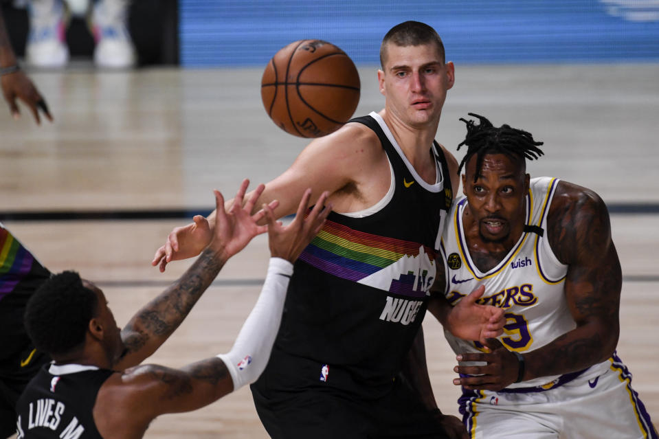 ORLANDO , FL - SEPTEMBER 22: Nikola Jokic (15) of the Denver Nuggets and Dwight Howard (39) of the Los Angeles Lakers tangle as Monte Morris (11) takes the ball during the second quarter at AdventHealth Arena at ESPN Wide World of Sports Complex in Orlando, Florida on Tuesday, September 22, 2020. (Photo by AAron Ontiveroz/MediaNews Group/The Denver Post via Getty Images)
