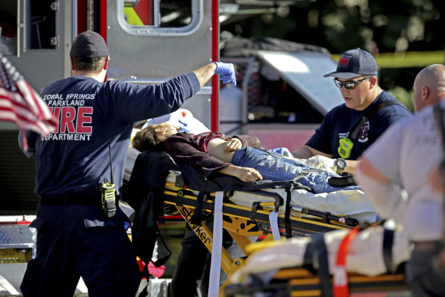 <p>Medical personnel tend to a victim following a shooting at Marjory Stoneman Douglas High School in Parkland, Fla., on Feb. 14, 2018. (Photo: John McCall/South Florida Sun-Sentinel via AP) </p>
