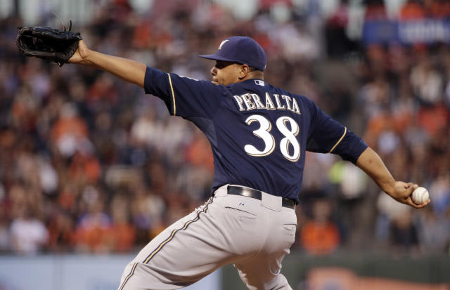 Milwaukee Brewers starting pitcher Wily Peralta throws to the San Francisco Giants during the first inning of a baseball game on Friday, Aug. 29, 2014, in San Francisco. (AP Photo/Marcio Jose Sanchez)