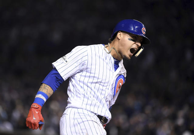 Javier Baez celebrates his fifth-inning home run against the Dodgers in Game 4 of the NLCS. (AP)