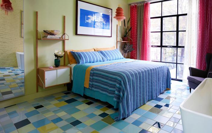 "Pardo's bedroom, one of three on the second level, is simply furnished with Ikea shelving <br> units and <a href=""https://www.linoto.com/"" rel=""nofollow noopener"" target=""_blank"" data-ylk=""slk:Linoto"" class=""link rapid-noclick-resp"">Linoto</a> linens."