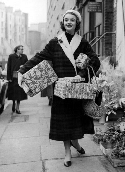 <p>Coats get longer and bags finally get bigger in 1956. Holiday shopping has never looked so fab. </p>