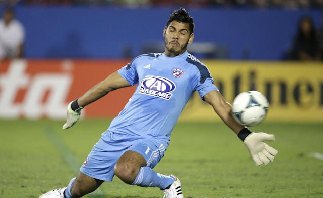 FC Dallas goalkeeper Raul Fernandez can't stop the shot, allowing a goal by Columbus Crew's Dominic Oduro during the first half of an MLS soccer game Sunday, Sept. 29, 2013, in Firsco, Texas. (AP Photo/LM Otero)