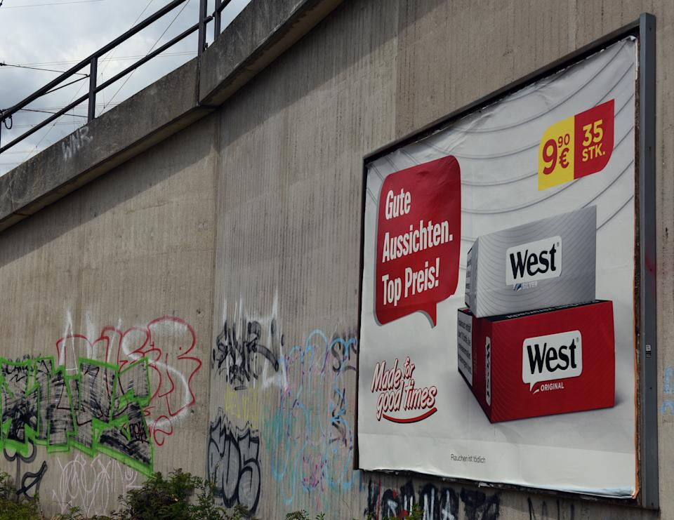 09 July 2019, North Rhine-Westphalia, Duesseldorf: A poster with tobacco advertising hangs on an underpass. Germany is the last EU country where tobacco advertising on advertising pillars and billboards is allowed. The associations of the advertising industry and the tobacco industry are trying to prevent a law banning advertising for cigarettes on advertising pillars and billboards. Photo: Horst Ossinger//dpa (Photo by Horst Ossinger/picture alliance via Getty Images)