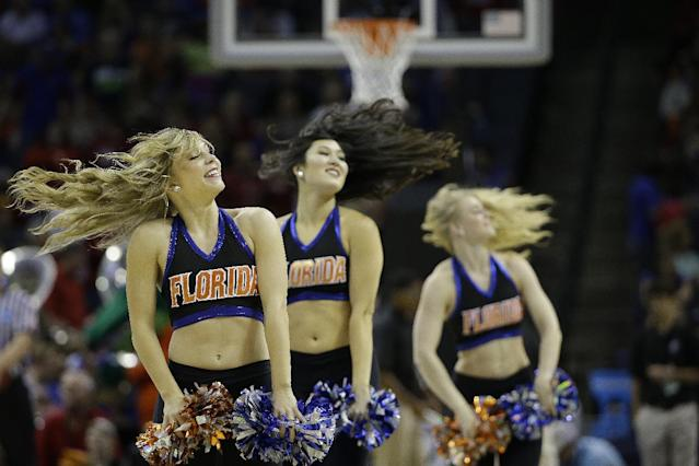 Florida cheerleaders perform against Dayton during the first half in a regional final game at the NCAA college basketball tournament, Saturday, March 29, 2014, in Memphis, Tenn. (AP Photo/Mark Humphrey)