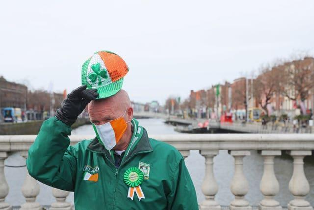 A man on O'Connell Bridge in Dublin joins in the festivities (Brian Lawless/PA)