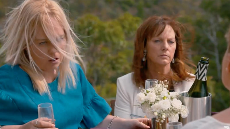 Sister and mum Dee and Donna sit on a cliffside picnic on Bride and Prejudice