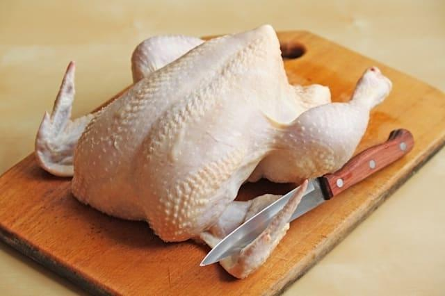 whole raw chicken on the...