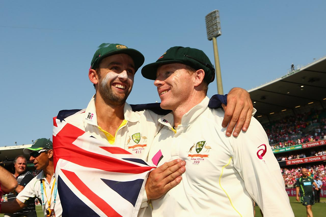 SYDNEY, AUSTRALIA - JANUARY 05: Nathan Lyon and Chris Rogers of Australia celebrate after winning the Ashes series 5-0 during day three of the Fifth Ashes Test match between Australia and England at Sydney Cricket Ground on January 5, 2014 in Sydney, Australia.  (Photo by Cameron Spencer/Getty Images)