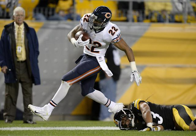 Chicago Bears running back Matt Forte (22), steps out of bounds after getting hit by Pittsburgh Steelers strong safety Troy Polamalu (43) on a long run in the first quarter of an NFL football game on Sunday, Sept. 22, 2013, in Pittsburgh. (AP Photo/Don Wright)
