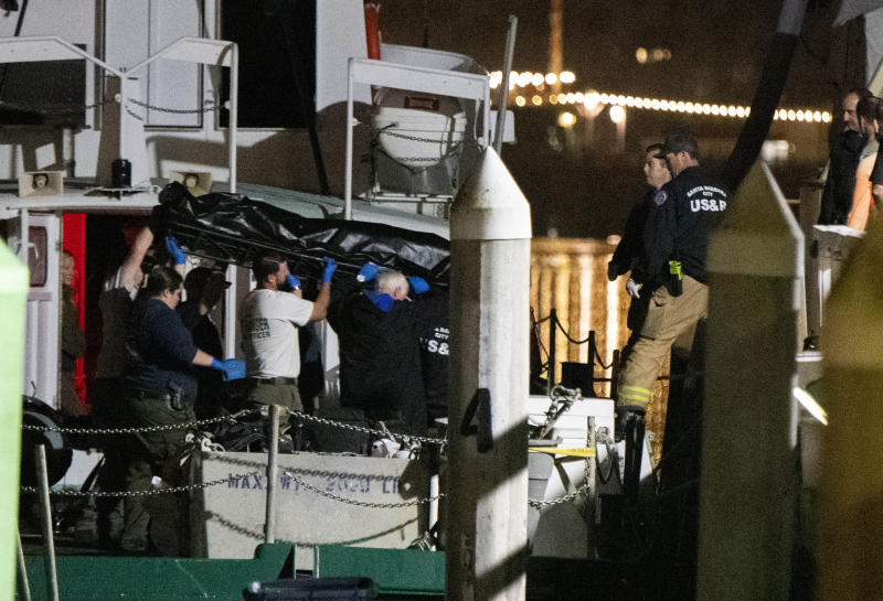 Local law enforcement along with search and rescue teams help unload the bodies of those who died in a diving boat fire, Monday, Sept. 2, 2019, in Santa Barbara, Calif. (Photo: Christian Monterrosa/AP)