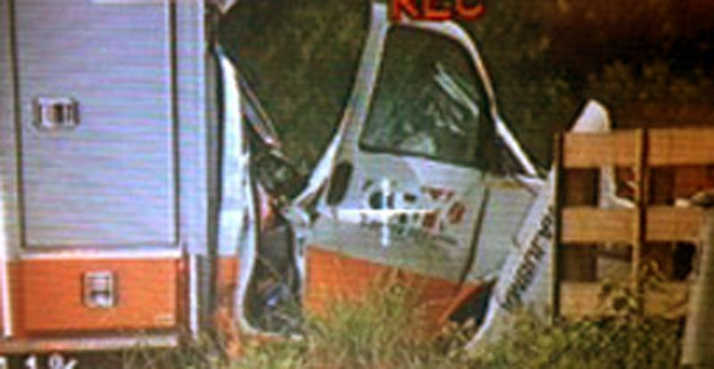 A Coffee County ambulance involved in a fatal accident is shown in this image taken from video provided by WALB TV Thursday, June 6, 2013 near Ocilla, Ga. Two medics and their patient on board were killed when the ambulance, with its lights and sirens, on collided with a semitrailer. It wasn't immediately known if the semitrailer driver was hurt. (AP Photo/WALB TV Albany)