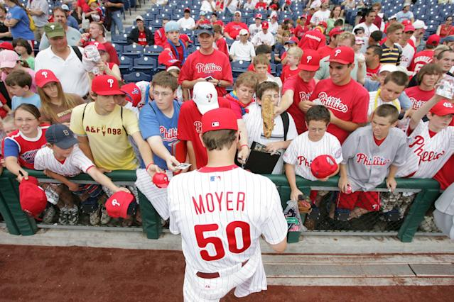 Pitcher Jamie Moyer #50 of the Philadelphia Phillies signs autographs before the game against the San Francisco Giants on June 3, 2007 at Citizens Bank Park in Philadelphia, Pennsylvania. The Phillies defeated the Giants 9-8.(Photo by Drew Hallowell/Getty Images)