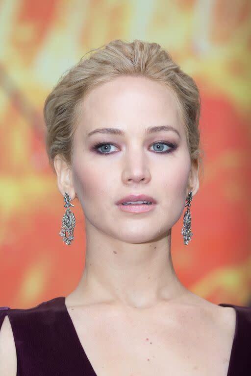 Jennifer Lawrence at the World Premier of The Hunger Games: Mockingjay Part 2 in Berlin, November 4 Take a tip from J. Law and don't be afraid to match your smoky eye to your dress. The actress looked stunning with a dimensional purple shadow and chic chignon. Use the Tom Ford Eye Color Quad in Lavender Lust ($80) to achieve the look. (Photo: Getty)