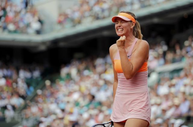 Maria Sharapova of Russia reacts during her women's singles final match against Simona Halep of Romania at the French Open tennis tournament at the Roland Garros stadium in Paris June 7, 2014. REUTERS/Stephane Mahe (FRANCE - Tags: SPORT TENNIS)