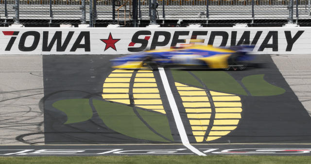 Alexander Rossi passes the finish line during practice for the IndyCar Series auto race Friday, July 19, 2019, at Iowa Speedway in Newton, Iowa. (AP Photo/Charlie Neibergall)