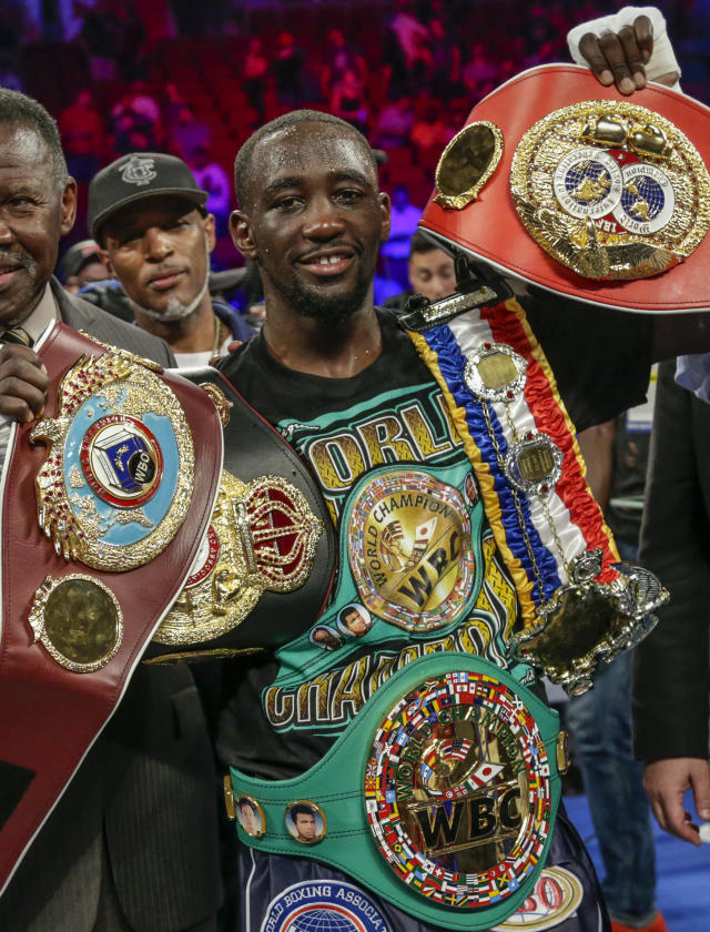 "FILE - In this Aug. 19, 2017, file photo, Terence ""Bud"" Crawford poses with his four title belts after winning by knockout against Julius Indongo in the third round of a junior welterweight world title unification bout in Lincoln, Neb. Crawford said hes eager to make unbeaten challenger Jose Benavidez Jr. eat his words when they meet in the ring in Omaha, Neb., on Oct. 13. (AP Photo/Nati Harnik, FIle)"