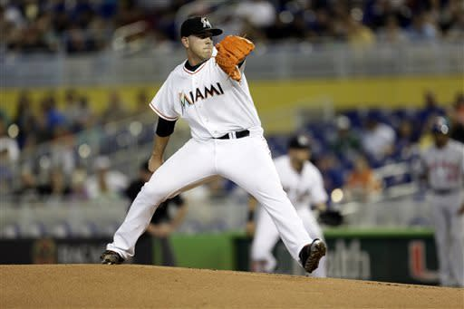 Miami Marlins starter Jose Fernandez throws to the New York Mets during the first inning of a baseball game in Miami, Saturday, June 1, 2013. (AP Photo/J Pat Carter)