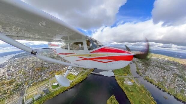 Some 30 pilots and volunteers flew 15 private aircraft to more than a dozen western Canadian towns in August to raise funds for the medical transport charity Hope Air.  (Hope Air / submitted - image credit)