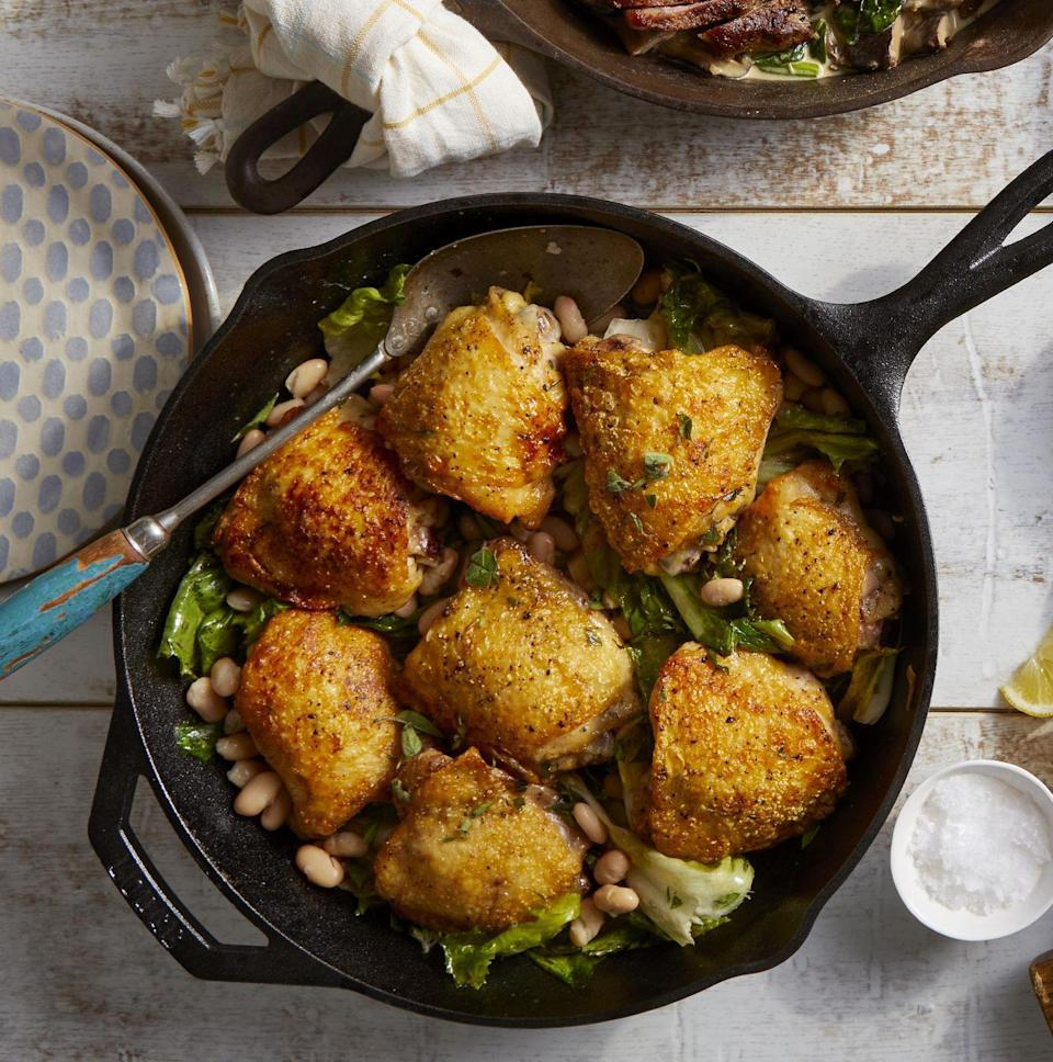 """<p>Looking for a healthy dinner that's also yummy and easy to make? This one-pan dinner has it all. Put it in your regular recipe rotation.</p><p><strong><a href=""""https://www.countryliving.com/food-drinks/a34945741/chicken-thighs-with-white-beans-and-escarole-recipe/"""" rel=""""nofollow noopener"""" target=""""_blank"""" data-ylk=""""slk:Get the recipe"""" class=""""link rapid-noclick-resp"""">Get the recipe</a>.</strong></p><p><a class=""""link rapid-noclick-resp"""" href=""""https://www.amazon.com/Victoria-Skillet-Seasoned-Flaxseed-Certified/dp/B01726HD72/?tag=syn-yahoo-20&ascsubtag=%5Bartid%7C10050.g.680%5Bsrc%7Cyahoo-us"""" rel=""""nofollow noopener"""" target=""""_blank"""" data-ylk=""""slk:SHOP CAST IRON SKILLETS"""">SHOP CAST IRON SKILLETS</a></p>"""