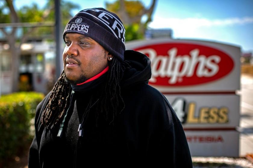 Henry Ephraim poses for a portrait outside the Ralphs/Food 4 Less distribution center in Compton