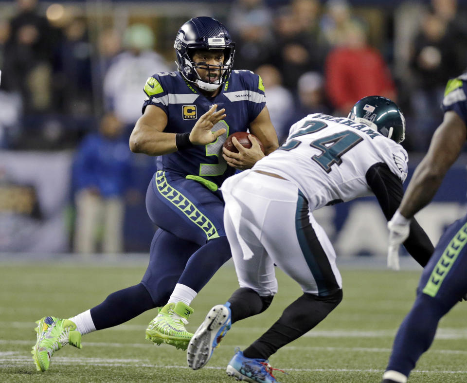 Seahawks quarterback Russell Wilson threw three touchdowns in Sunday night's victory over the Eagles, bringing him to a tie with Tom Brady for the second-most in the NFL. (AP)