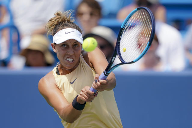 Madison Keys, of the United States, returns to Svetlana Kuznetsova, of Russia, in the women's final match during the Western & Southern Open tennis tournament Sunday, Aug. 18, 2019, in Mason, Ohio. (AP Photo/John Minchillo)