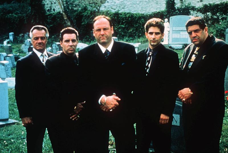 """FILE - This undated publicity image released by HBO shows, from left, Tony Sirico, Steven Van Zandt, James Gandolfini, Michael Imperioli and Vicint Pastore,from the HBO drama series """"The Sopranos."""" HBO and the managers for Gandolfini say the actor died Wednesday, June 19, 2013, in Italy. He was 51. (AP Photo/HBO, Anthony Neste, file)"""