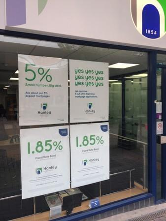 Advertising posters of the Hanley Economic Building Society are seen placed on a window at their branch in Stoke-on-Trent