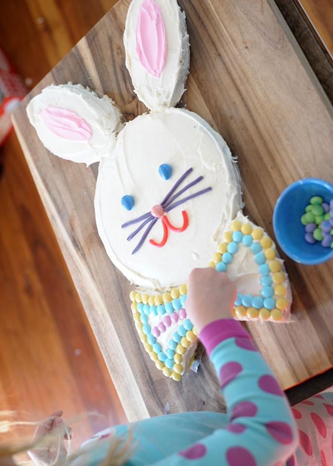 """<p>This simple, cut-out cake is a candy lover's dream! To decorate, just grab some frosting and colorful M&M's, then let your imagination run wild.</p><p><em><a href=""""https://www.aliceandlois.com/easter-bunny-cake/"""" target=""""_blank"""">Get the recipe from Alice and Lois »</a></em> </p>"""