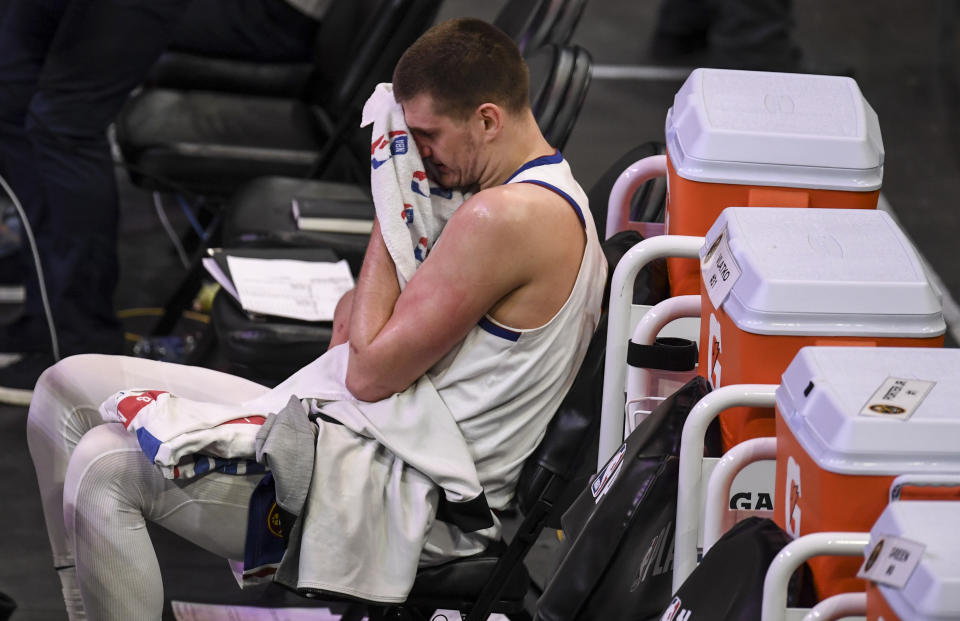 PHOENIX, AZ - JUNE 9: Nikola Jokic (15) of the Denver Nuggets wipes sweat from his face as he sits alone on the bench against the Phoenix Suns during the third quarter at Phoenix Suns Arena on Wednesday, June 9, 2021. The Phoenix Suns hosted the Denver Nuggets for game two of their best-of-seven NBA Playoffs series. (Photo by AAron Ontiveroz/MediaNews Group/The Denver Post via Getty Images)