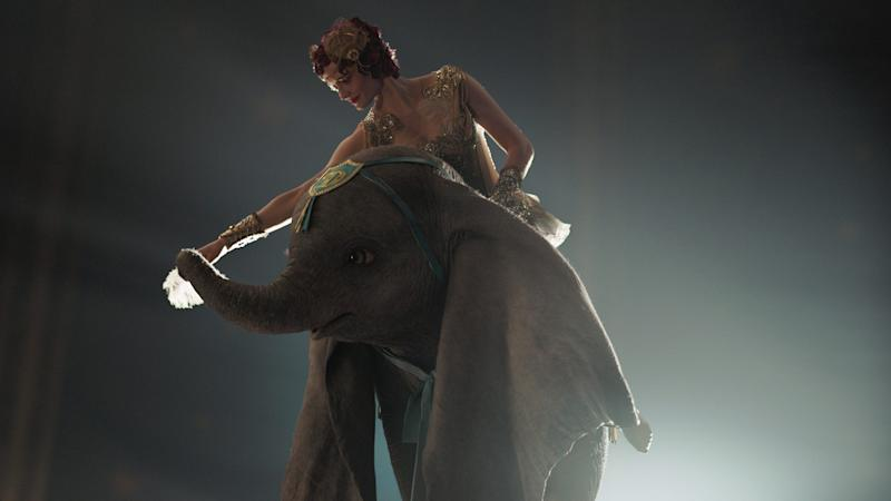 The aerialist Colette Marchant (Eva Green) prepares to take flight with the title elephant of Tim Burton's