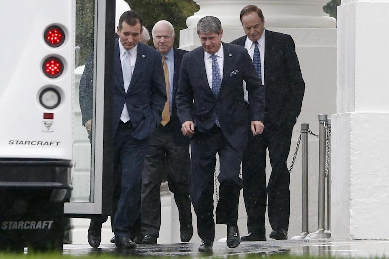 Republican senators, from left, Ted Cruz of Texas, John McCain of Arizona, David Vitter of Louisiana, and Richard Shelby of Alabama, walk in the rain back to their bus at the North Portico of the White House in Washington, Friday, Oct. 11, 2013, after they met with President Barack Obama regarding the government shutdown and debt ceiling. After weeks of ultimatums, President Barack Obama and congressional Republicans are exploring whether they can end a budget standoff that has triggered a partial government shutdown and edged Washington to the verge of a historic, economy-jarring federal default. (AP Photo/Charles Dharapak)(AP Photo/Charles Dharapak)