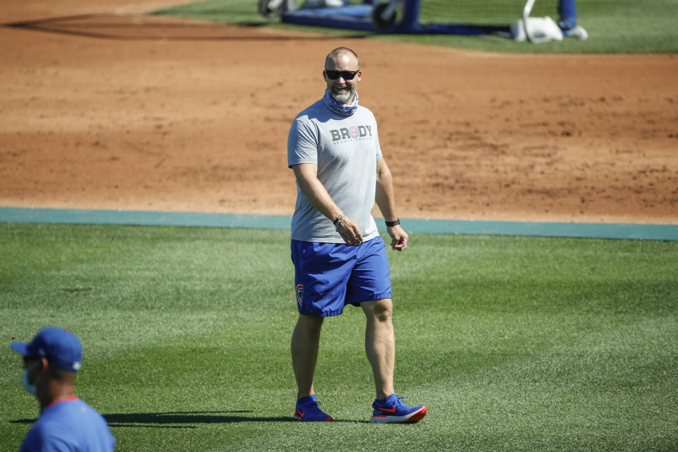 Chicago Cubs manager David Ross smiles during baseball practice at Wrigley Field on Friday, July 3, 2020 in Chicago. (AP Photo/Kamil Krzaczynski)