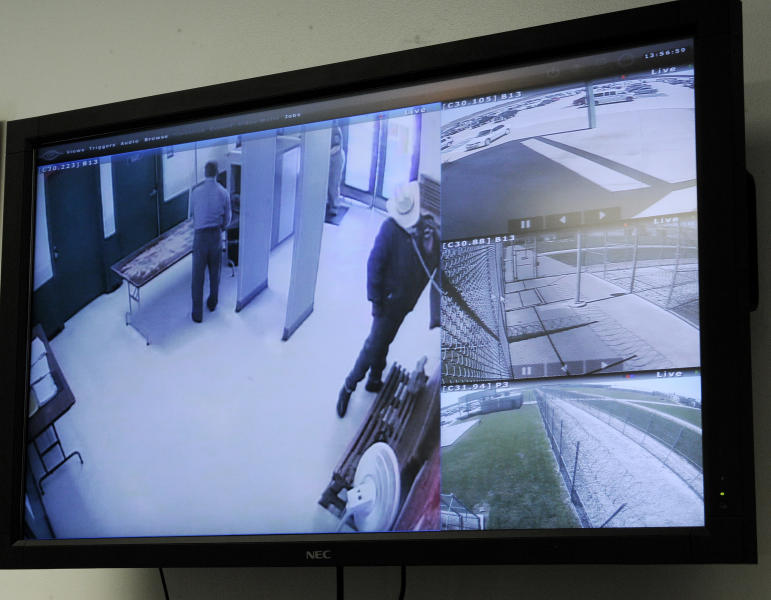 A screen in the warden's office at the Stiles Unit of the Texas Department of Criminal Justice displays view from different security cameras at the prison Wednesday, March 13, 2013, in Beaumont, Texas. New technology is being installed at the prison unit to divert calls, texts, emails and internet log-in attempts from contraband phones. (AP Photo/Pat Sullivan)