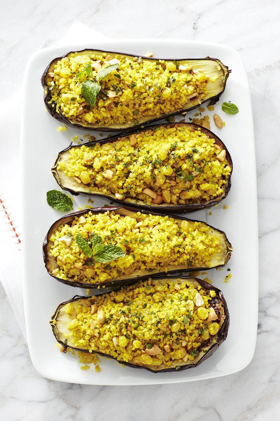 "<p>Eggplants are the perfect edible bowls for all kinds of fillings, but we're digging this vegetarian curry situation.</p><p><em><a href=""https://www.goodhousekeeping.com/food-recipes/a16733/bulgur-cashew-stuffed-eggplant-recipe-ghk0215/"" rel=""nofollow noopener"" target=""_blank"" data-ylk=""slk:Get the recipe for Bulgur and Cashew Stuffed Eggplant »"" class=""link rapid-noclick-resp"">Get the recipe for Bulgur and Cashew Stuffed Eggplant »</a></em></p><p><strong>RELATED: </strong><a href=""https://www.goodhousekeeping.com/food-recipes/healthy/g908/vegetarian-recipes/"" rel=""nofollow noopener"" target=""_blank"" data-ylk=""slk:46 Hearty Vegetarian Recipes for the Whole Family"" class=""link rapid-noclick-resp"">46 Hearty Vegetarian Recipes for the Whole Family</a></p>"
