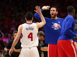 Spencer Hawes contributes. (Stephen Dunn/Getty Images)