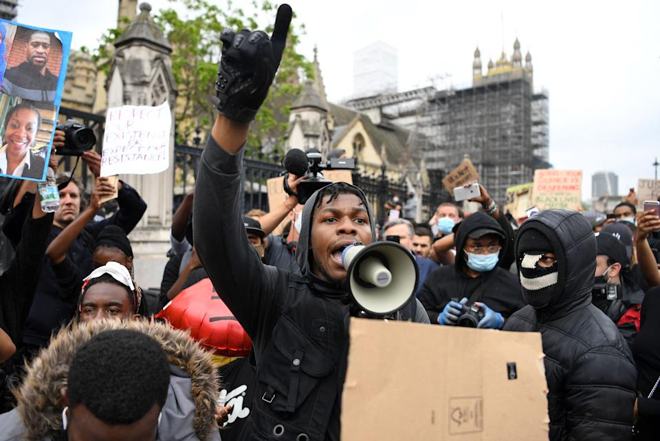 John Boyega speaks to protestors in Parliament square during an anti-racism demonstration in London, on June 3, 2020. (Photo by Daniel Leal-Olivas/AFP via Getty Images)