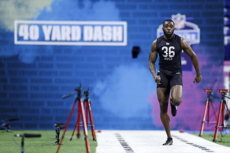 Wide receiver Denzel Mims of Baylor runs the 40-yard dash during the NFL Scouting Combine