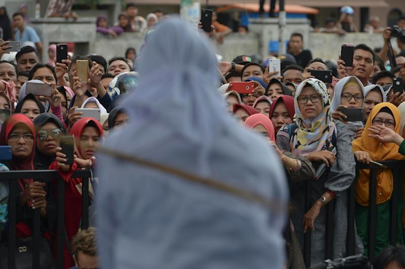 Rights groups have derided it as cruel and last year President Joko Widodo called for an end to public whippings in Aceh (AFP Photo/CHAIDEER MAHYUDDIN)