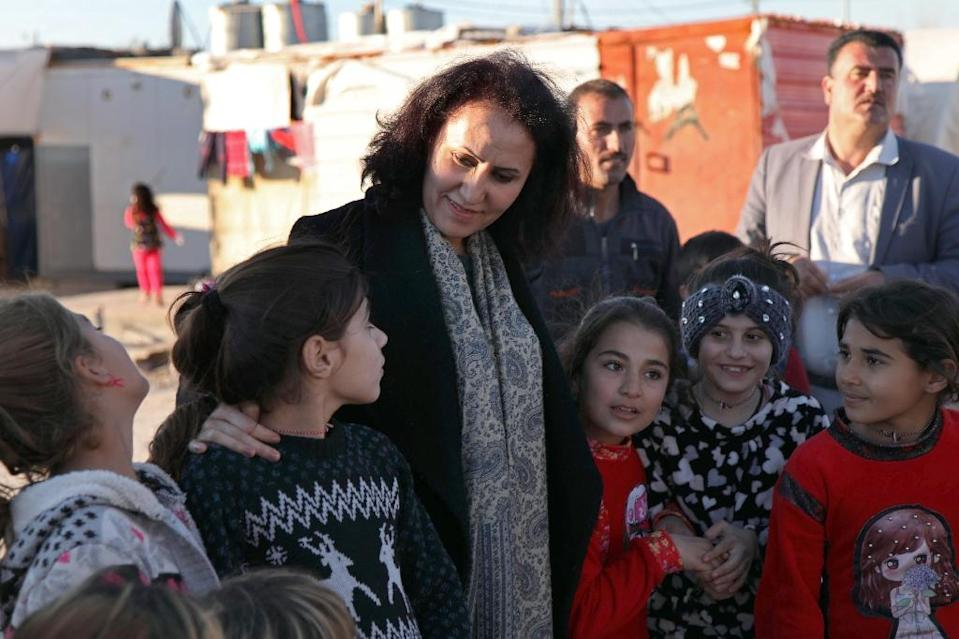 Nagham Hasan, a 41-year-old gynaecologist, with children in the Kabarto Camp (AFP Photo/SAFIN HAMED)
