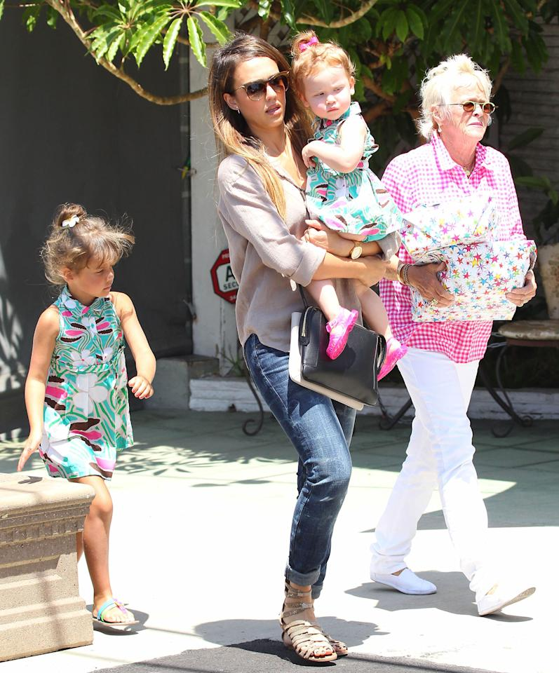 Two cute! Jessica Alba dressed her little ladies, Honor, 5, and Haven, who will be 2 on August 13, in matching dresses for a trip to the toy story. (8/3/2013)