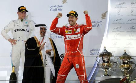 Formula One - F1 - Bahrain Grand Prix - Sakhir, Bahrain - 16/04/17 - Ferrari Formula One driver Sebastian Vettel of Germany (R) celebrates after winning Bahrain Grand Prix. REUTERS/Hamad I Mohammed