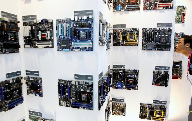 A man looks at motherboards displayed at the AMD booth during the Computex 2011 computer fair at the TWTC Nangang exhibition hall in Taipei