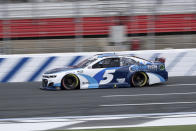 Kyle Larson qualifies in pole position for the NASCAR Cup Series auto race at Charlotte Motor Speedway on Saturday, May 29, 2021 in Charlotte, N.C. (AP Photo/Ben Gray)