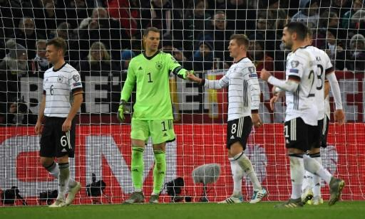 Germany's goalkeeper Manuel Neuer fist bumps Toni Kroos after saving a penalty against Belarus on Saturday