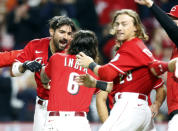 Cincinnati Reds Nick Castellanos, left, celebrates with teammates Jonathan India, center, and TJ Friedl after hitting a home run against Washington Nationals pitcher Patrick Murphy to win a baseball game during the ninth inning in Cincinnati, Saturday, Sept. 25, 2021. (AP Photo/Paul Vernon)