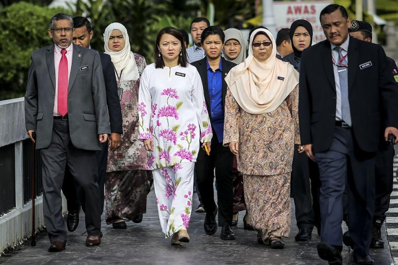 Mohamed Hanipa Maidin (left), Hannah Yeoh (centre) and Fuziah Salleh (second right) arrive at the Anti-child marriage protest outside the Parliament in Kuala Lumpur November 13, 2018.