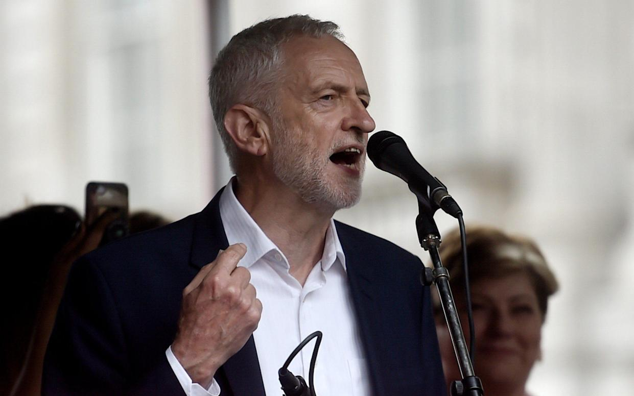 Jeremy Corbyn speaks to protesters - Getty Images Europe