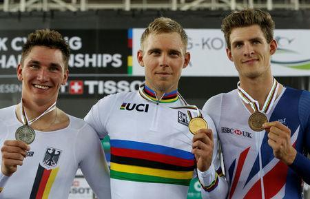 Cycling - UCI Track World Championships - Men's Scratch Race, Final - Hong Kong, China – 13/4/17 - Germany's Lucas Liss, Poland's Adrian Teklinski and Britain's Christopher Latham celebrate with their medals on the podium. REUTERS/Bobby Yip